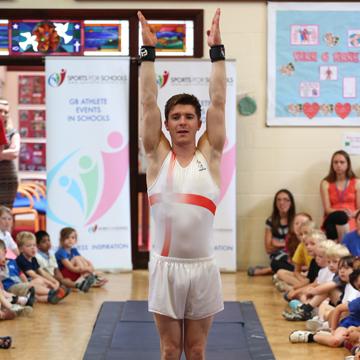 Danny Lawrence demonstrating gymnastics