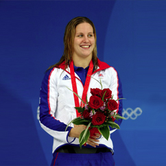 Joanne Jackson GB swimmer holding medal and flowers