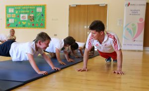 Danny Lawrence enjoying some push-ups with some children at an event